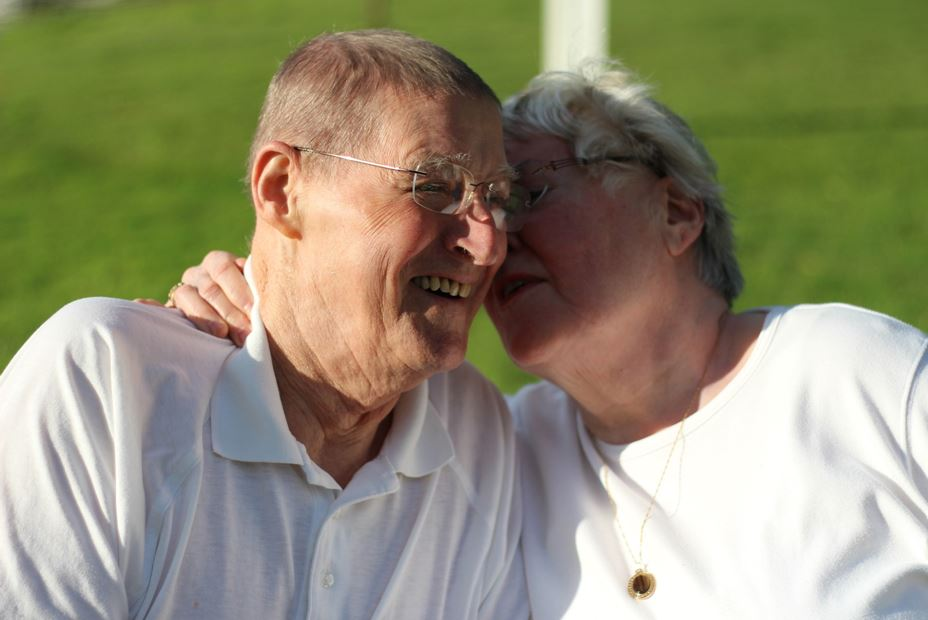 grandparents outdoors snuggling