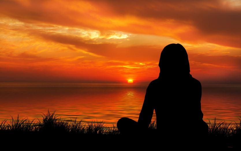 sunset-woman silhouette meditation